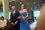 Erin is escorted up the aisle.